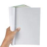 Hand holding magazine royalty free stock photography