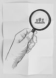 Hand holding magnifier glass looking for employee Stock Photo
