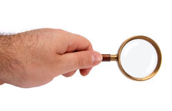 Hand holding magnifying glass. Isolated on white stock photo