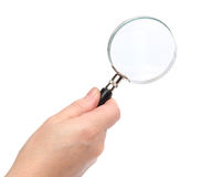 Hand holding a magnifying glass Royalty Free Stock Image