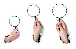 Hand holding a magnifying glass Royalty Free Stock Photos