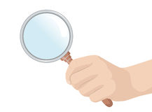Hand holding a magnifying glass Stock Photos