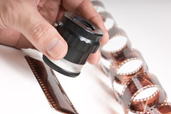 Hand holding  magnifying glass and film Royalty Free Stock Image