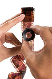 Hand holding  magnifying glass and film Royalty Free Stock Photo