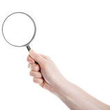 Hand holding magnifying glass Stock Photos