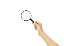 Hand holding magnifying glass royalty free stock photo