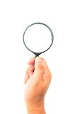 Hand holding magnifying glass Royalty Free Stock Image