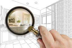 Free Hand Holding Magnifying Glass Revealing Custom Bathroom Design Drawing And Photo Combination Royalty Free Stock Photo - 150055635
