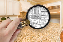 Hand Holding Magnifying Glass Revealing Custom Kitchen Design Dr Royalty Free Stock Images