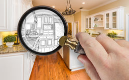 Hand Holding Magnifying Glass Revealing Custom Kitchen Design Dr Royalty Free Stock Image