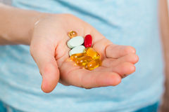 Hand holding many different pills Stock Photo