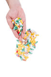 Hand holding many pills Stock Images