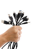 Hand holding Many USB cable Royalty Free Stock Photography