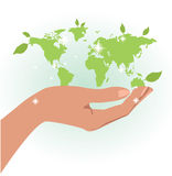 Hand holding the map of the world Royalty Free Stock Images