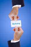 Hand holding marketing card Stock Images