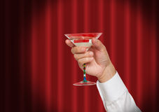 Hand holding a martini drink Royalty Free Stock Photography