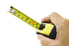 Hand holding measuring tape Royalty Free Stock Photos