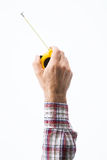 Hand holding a measuring tape. Male constructor's hand holding a measuring tape on white background Royalty Free Stock Photos