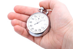 Hand holding mechnical stopwatch Royalty Free Stock Photo