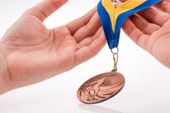 Hand holding medal Royalty Free Stock Images