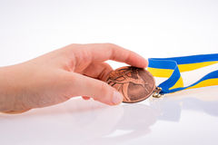 Hand holding medal Royalty Free Stock Photography