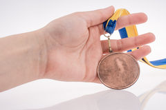 Hand holding medal Stock Photos