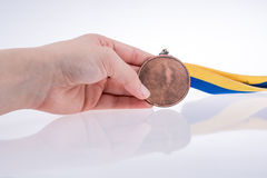 Hand holding medal Royalty Free Stock Image