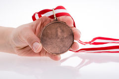 Hand holding medal Stock Photo