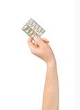 Hand holding medical drugs - full silver leaflet Royalty Free Stock Image