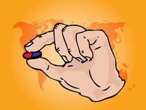 Hand holding medicine Stock Image