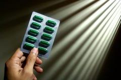 Hand holding medicine capsules Stock Photo