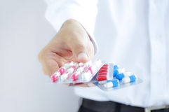 Hand holding medicines in blister packs Royalty Free Stock Photo