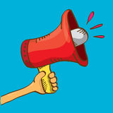 Hand holding megaphone on blue background. Royalty Free Stock Image