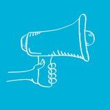 Hand holding megaphone on blue background. Stock Photography
