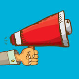 Hand holding megaphone on blue background. Stock Photography