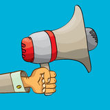 Hand holding megaphone on blue background. Stock Image