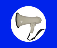 Hand holding Megaphone, Loudspeaker. Mouthpiece in the background.  Royalty Free Stock Images