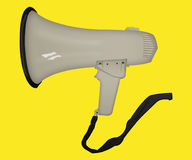 Hand holding Megaphone, Loudspeaker. Mouthpiece in the background.  Royalty Free Stock Photography