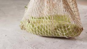 Hand holding mesh shopping bag with corn. Zero waste concept. Eco friendly. Hand holding mesh shopping bag with corn. Zero waste concept stock video