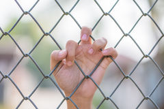 Hand holding on Metal Grille Stock Images
