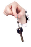 Hand holding metal key Stock Images
