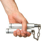 Hand holding a metal nunchaku Royalty Free Stock Images