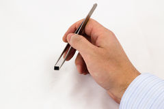 Hand holding a Microchip on tweezers Stock Photo