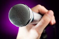 Hand holding the microphone Royalty Free Stock Image