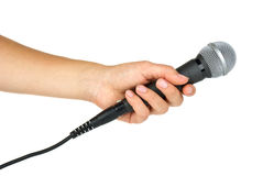 Hand holding microphone. Isolated on the white background Royalty Free Stock Photography