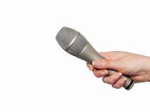 Hand holding microphone. Woman's hand holding microphone isolated on white Stock Images