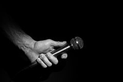 Hand holding microphone. Image of a hand holding a microphone Royalty Free Stock Photography