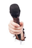 Hand holding microphone Royalty Free Stock Image