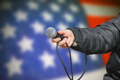 Hand holding microphone in american survey Stock Photos