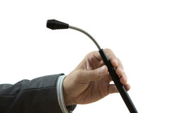 A hand holding a microphone Stock Image